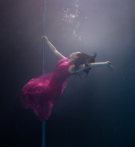 PIC BY BRETT STANLEY/ CATERS NEWS - (PICTURED: Pole dancer Maranda Sun) - A photographer has made a splash with his spectacular images of underwater pole dancers. Brett Stanley captured the beauty and talent of his subjects as they gracefully danced in the water. Shot over a few weeks in conjunction with pole dance supplier X-Pole, he worked with the dancers to create the series. Brett taught them how to hold their breath under the water and collaborated on which poses looked best.