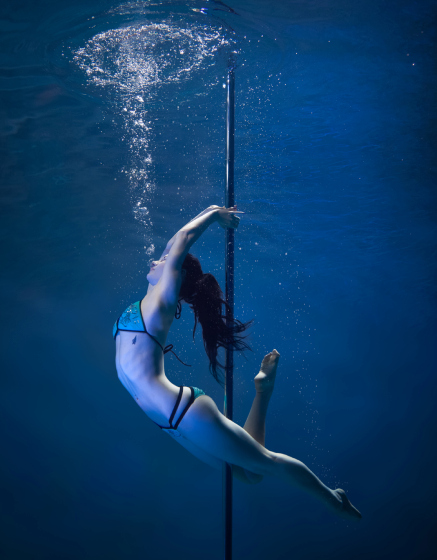 PIC BY BRETT STANLEY/ CATERS NEWS - (PICTURED: Pole dancer Skylar Leigh) - A photographer has made a splash with his spectacular images of underwater pole dancers. Brett Stanley captured the beauty and talent of his subjects as they gracefully danced in the water. Shot over a few weeks in conjunction with pole dance supplier X-Pole, he worked with the dancers to create the series. Brett taught them how to hold their breath under the water and collaborated on which poses looked best.