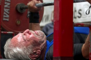 In this June 8, 2013 photo, Sy Perlis  91-years-old, prepares to take the weight of the bench press in Phoenix. Perlis, a 91-year-old Arizona weightlifter didn't just break a world record for the bench press, he powered through it by 52 pounds (23.5 kilograms).  Sy Perlis set the record by benching 187.2 pounds (85 kilograms) at the National Bench Push-Pull Press and Dead Lift Championships on Saturday in Phoenix.  (AP Photo/The Arizona Republic, Patrick Breen)  MARICOPA COUNTY OUT; MAGS OUT; NO SALES
