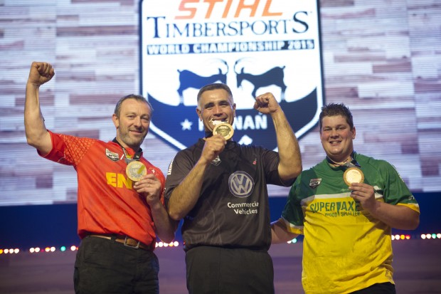 Christophe Geissler of Switzerland (left), Jason Wynyard of New Zealand and Brayden Meyer of Australia celebrate on the podium during the single competition at the STIHL TIMBERSPORTS® World Championship in Poznan, Poland on November 14, 2015.