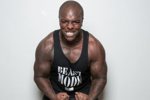adebayo-akinfenwa-showing-off-his-muscles-and-strength