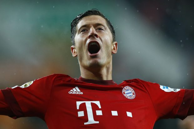 Bayern's Robert Lewandowski celebrates after scoring his side's second goal during the German first division Bundesliga soccer match between FC Augsburg and FC Bayern Munich at the WWK Arena in Augsburg, Germany, Sunday, Feb. 14, 2016. (AP Photo/Matthias Schrader)
