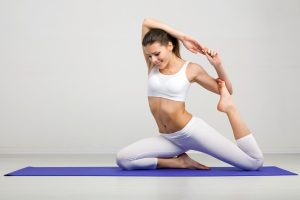 Woman doing stretching exercises in a gym