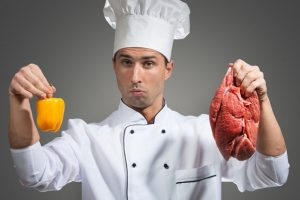 chef-holding-bell-pepper-and-meat